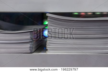 catalogues kept in a shelf with beautiful light background