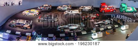 STUTTGART GERMANY- MARCH 19 2016: Panoramic view of the gallery of sports and racing cars of different classes. Mercedes-Benz Museum.