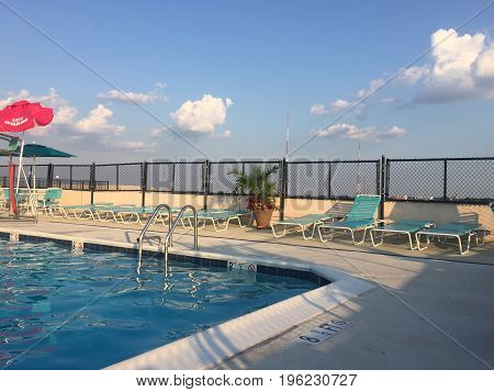Rooftop swimming pool with summer sky in the background
