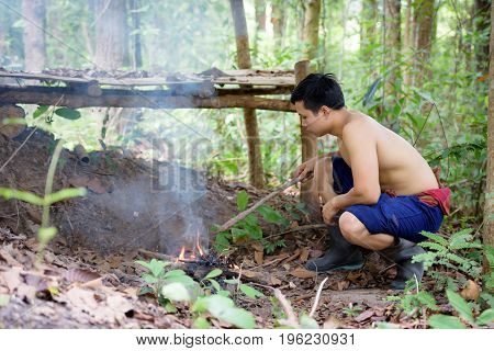 The peasants are burning fire in the forest