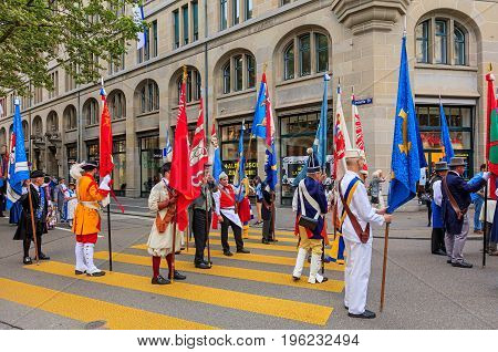 Zurich, Switzerland - 1 August, 2016: participants of the parade devoted to the Swiss National Day passing along a street in the center of the city. The Swiss National Day is the national holiday of Switzerland, celebrated on 1 August.
