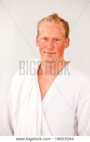 A portrait of a content man wearing a bathrobe