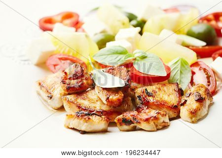 Spicy Chicken Pieces with tomato Salad