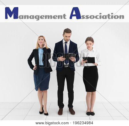 Concept of management association. Business people on light wall background
