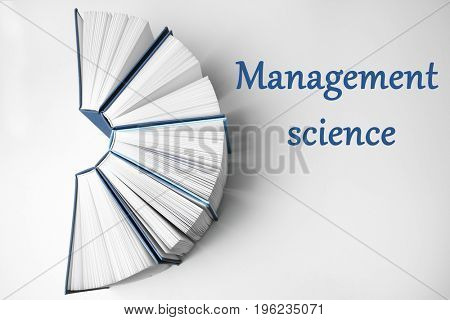 Text MANAGEMENT SCIENCE and books on white background