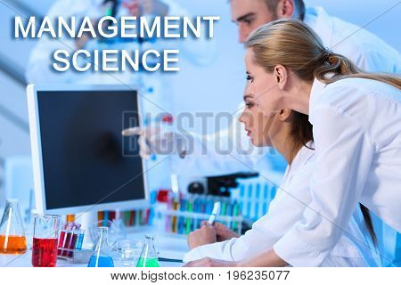 Concept of management science. Young people working in laboratory