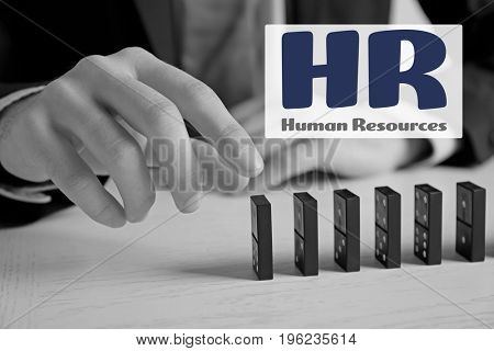 Concept of human resources management. Man with dominoes, closeup