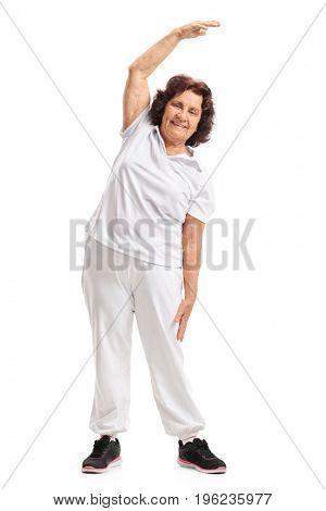 Full length portrait of an elderly woman exercising isolated on white background