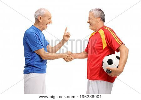 Two elderly soccer players shaking hands isolated on white background