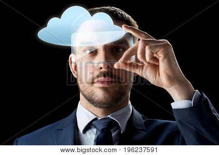 business, augmented reality and future technology concept - businessman in suit working with transparent smartphone and cloud computing hologram over black background