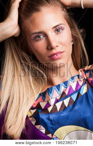 beauty young blonde woman portrait with interesting  makeup eyelashes and crystals