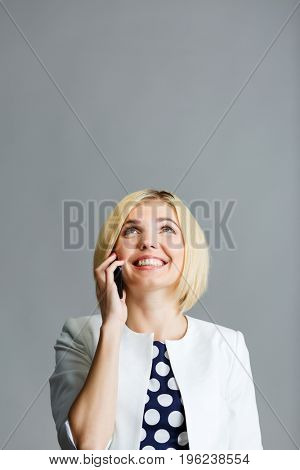 Beautiful blonde talking on phone