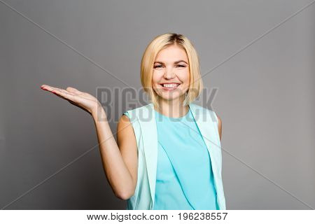 Blonde on empty gray background