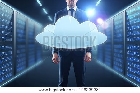 business, people and technology concept - businessman in suit with virtual cloud hologram over server room background