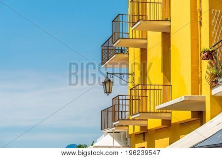 Fragment of a colorful apartment building in Malcesine, Lake Garda, Italy.