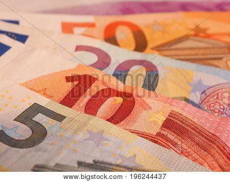 Close up of Euro notes on a table financial concept background