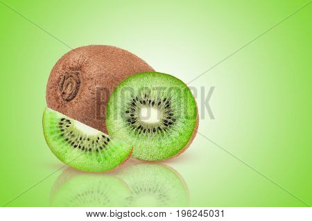 Ripe whole kiwi fruit and half kiwi fruit on green background.