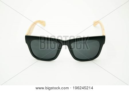 black sunglasses with wooden legs on white background