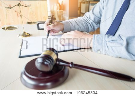 Lawyer Hand Writes The Document In Court (justice, Law)