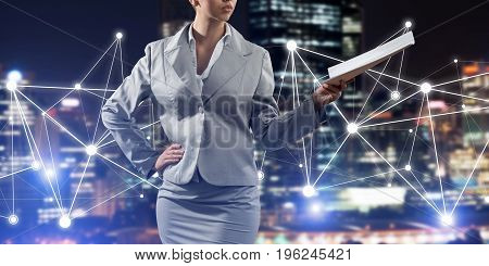 Close of businesswoman holding papers in hand and connection lines at background