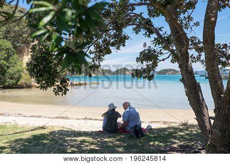 Urupukapuka Island Bay of Islands New Zealand NZ - February 1 2017: Elderly tourists by the beach.