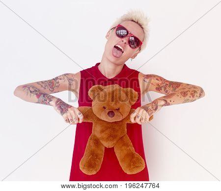 Caucasian blonde women with teddy bear