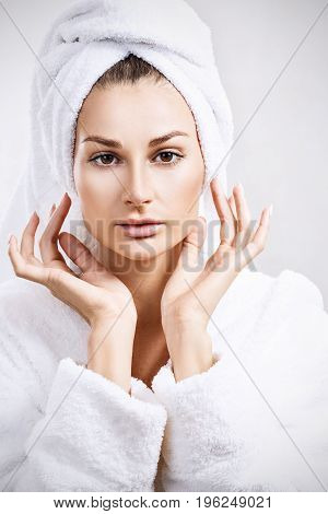 Young woman face with perfect skin and bath towel on head.