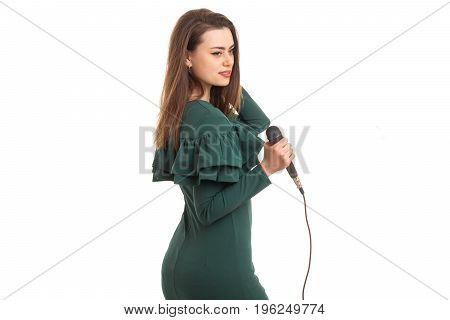 pretty woman in green color dress with microphone in hands isolated on white background