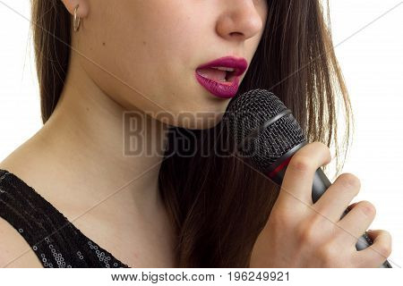 close up of woman lips with micrphone isolated on white background