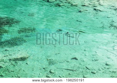 Clear turquoise water with stones in the beautiful Eibsee