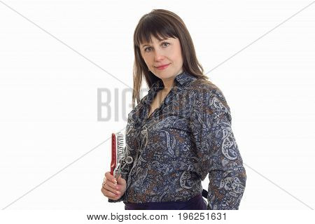 portrait of adult woman with hairstyle tools in hands looking at the camera isolated on white background