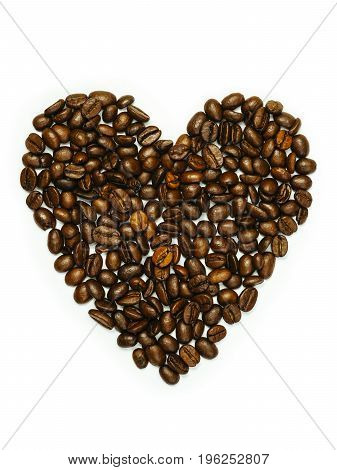 Photo of coffee beans in heart shape isolated over white background.