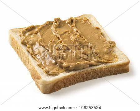 Photo of a slice of white bread covered in peanut butter. Isolated on white with clipping path included.