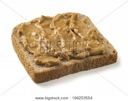 Photo of a slice of whole wheat bread covered in peanut butter. Isolated on white with clipping path included.