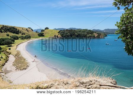Urupukapuka Island Bay of Islands New Zealand NZ - February 1 2017: Holiday makers in summer on a secluded beach.