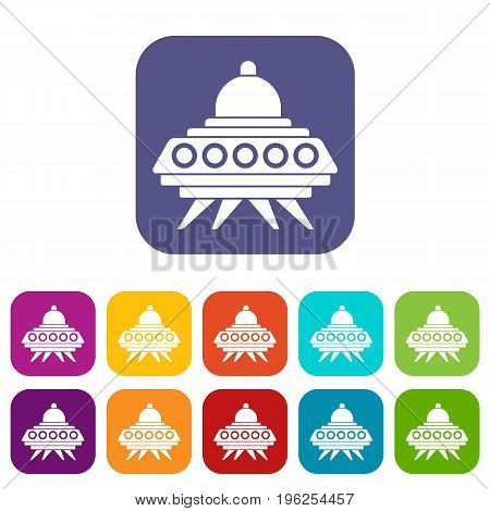 Alien spaceship icons set vector illustration in flat style in colors red, blue, green, and other