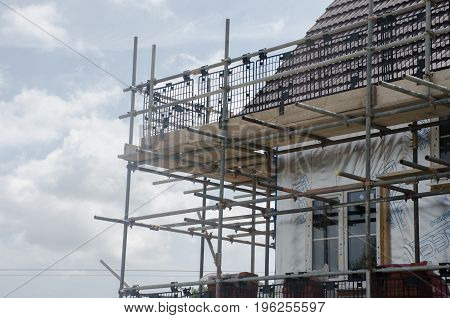 Elmstead Essex United Kingdom -17 July 2017: Scaffolding on corner of housing development