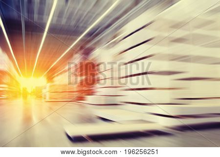Blurred background storage is in motion with light sun Concept interior modern logistics space. Copyspace