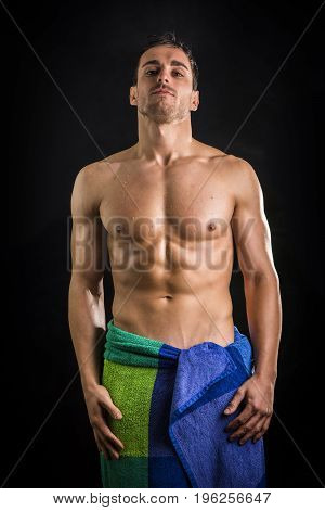 Portrait of naked handsome young man with languishing look with a towel around his waist
