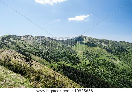 Hromove Chleb Velky Krivan and other hills from Steny hill in Mala Fatra mountain range in Slovakia during nice say with blue sky and only few clouds
