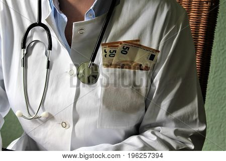 An Image of a corrupt doctor with money