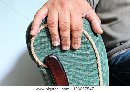 An Image of a armchair with a hand