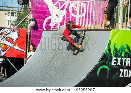 Skateboarder Doing A Trick In A Skate Park