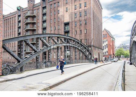 HAMBURG GERMANY - JULY 14, 2017: Hamburg Germany - July 14, 2017: People visiting the Pogennmuehlen bridge in the warehouse district Hamburg
