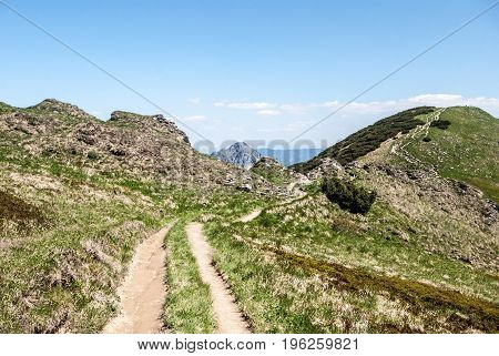 Hromove and Velky Rozsutec hill from hiking trail between Hromove and Chleb hill in Mala Fatra mountains in Slovakia during spring day with bluer sky