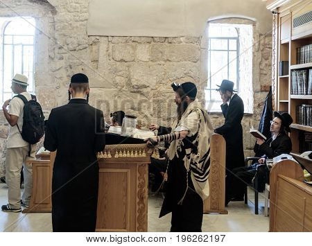 Jerusalem Israel July 14 2017 : Religious Jewish men read prayers in the Tomb of King David in the old city of Jerusalem Israel