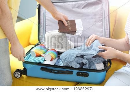 Gay couple preparing for trip