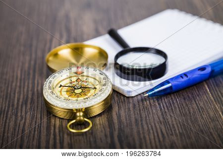 Compass, Magnifying Glass And  Notebook