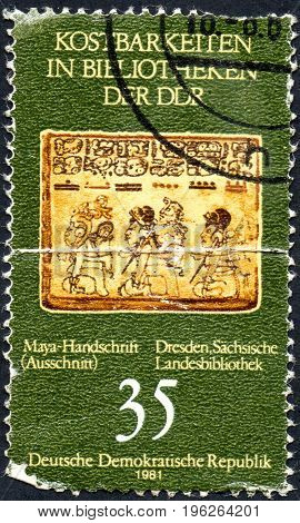 UKRAINE - CIRCA 2017: A stamp printed in DDR shows Maya manuscript from series Treasure In The Library Of The GDR circa 1981