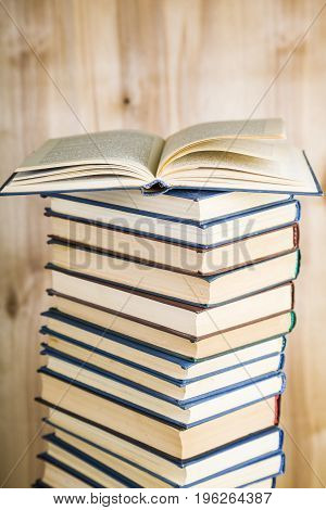 Stack Of Books On A Wooden Background.